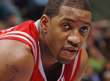 Frustrated Tracy McGrady throws down Chinese player with malicious elbow – VIDEO