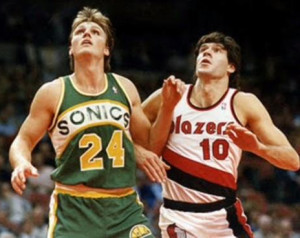Fernando Martin (right) battles Tom Chambers for a rebound