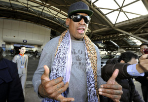 rodman-hands-airport
