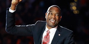 Mutombo smiles from ear to ear, watching Hawks retire his jersey